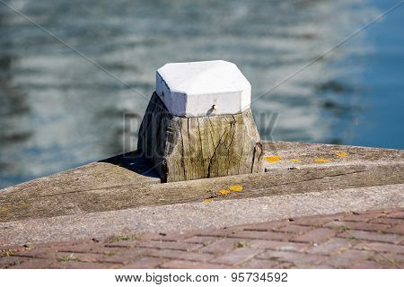 Wooden With White Bollard In The Harbour