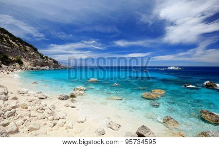 Cala Mariolu on a clear day with soft white clouds Sardinia
