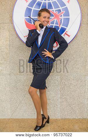 Beautiful Smiling Stewardess With Radio