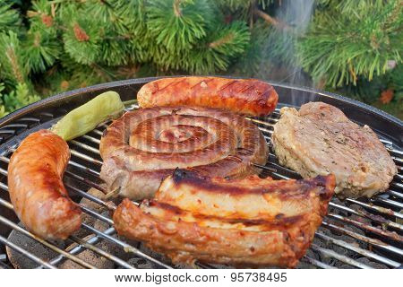 Close-up Of Meat Assortment On Hot Bbq Grill