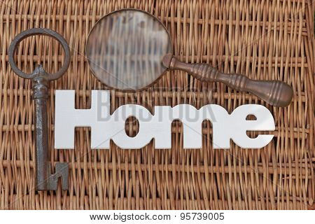 Wood Sign Home, Old Key, Vintage Magnifier On Wicker Background
