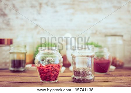 Goji And Chia Seeds (superfood) On Wooden Tabe