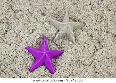 Sand Starfish And Plasyic Mold On The Beach