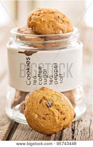 Handmade Chocolate Chip Cookies In Glass Jar, On Wooden Board