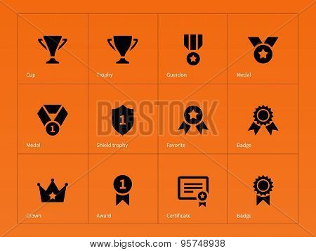 Medals and cup icons on orange background.