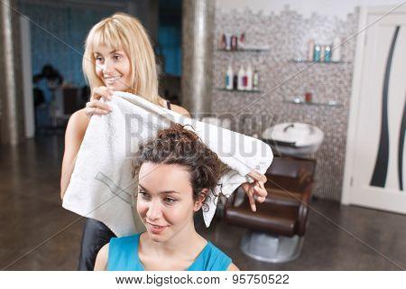 Nice girl washing her head in beauty salon