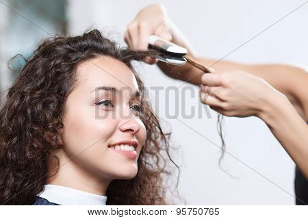 Smiling attractive client enjoying hairstyling