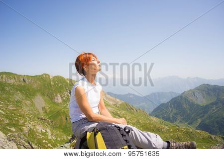 Red Haired Woman Sunbathing On The Mountain Top