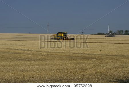 The Old And New Farm Vehicle Collects Cereals