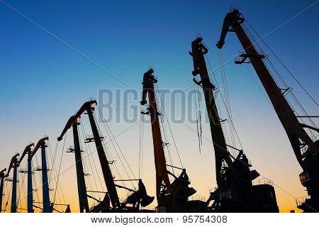 port cranes at sunset