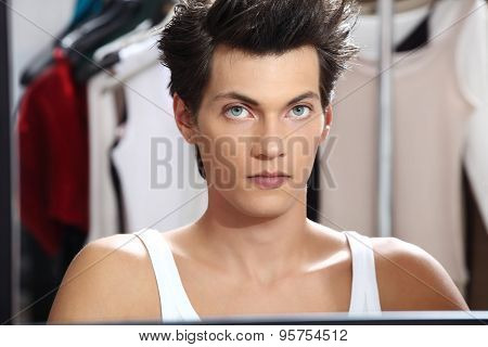 Portrait Of Handsome Model At Mirror In Dressing Room