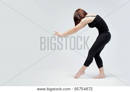 athletic girl on white background, pushing something