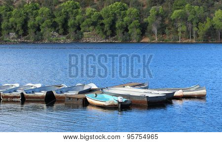 Lake with boats at summer camp