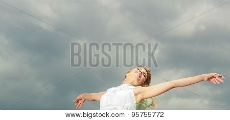 Woman Happy Joyful With Arms Up Against Sky