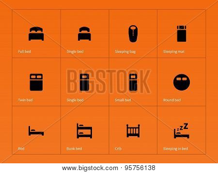 Bed, crib and sleeping bed icons on orange background.