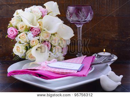Pink Theme Wedding Table Setting On Dark Wood Background.