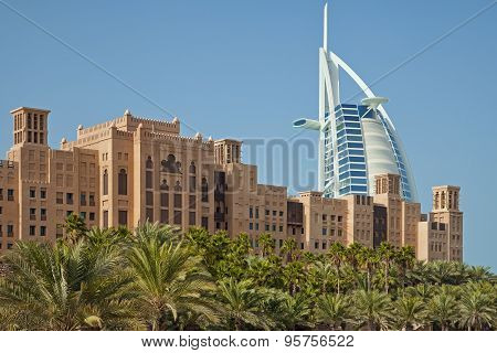 Burj Al Arab Behind Arabic Buildings And Palm Trees Of Dubai In Madinat Jumeirah