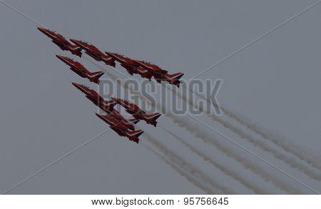 Red Arrow Display Team Flying in dark sky