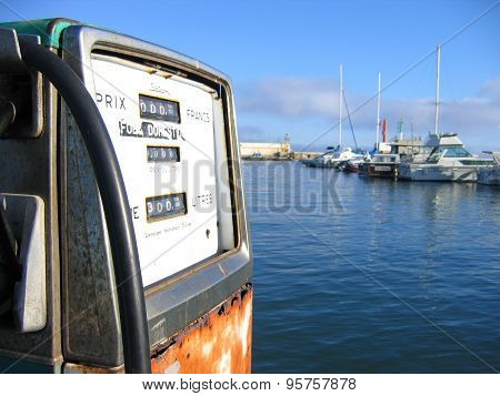 Old rusty gas pump near the sea