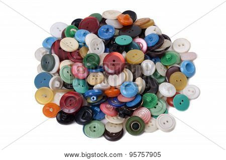 Pile Of Old Colored Buttons On White Background