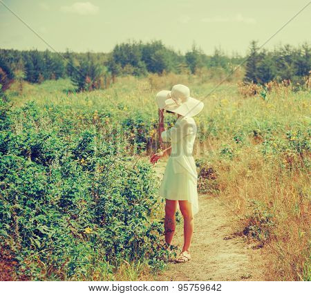 Beautiful Girl Walking In Summer Park
