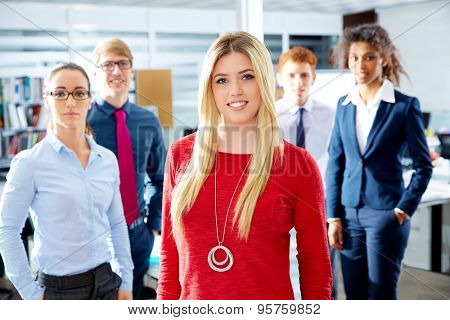Blond young businesswoman multi ethnic teamwork group as leader in office