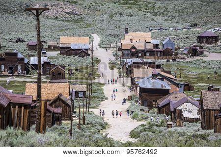 BODIE, CALIFORNIA, USA - July 6, 2015:  Groups of summer tourists visiting Bodie ghost town in California's Bodie State Historic Park.