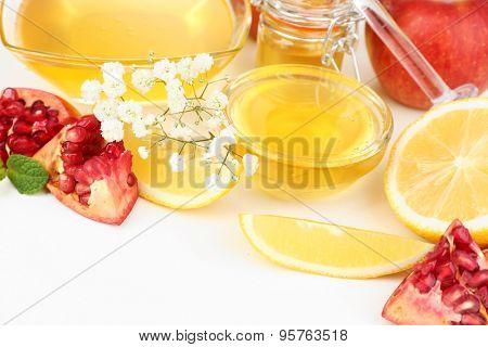 Sweet honey with pomegranate and lemon close up