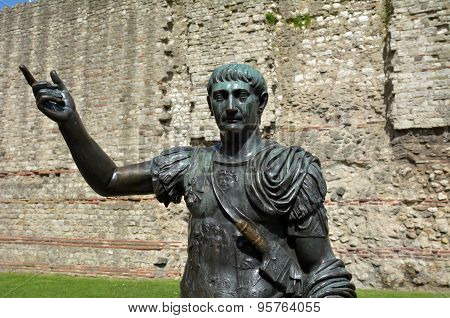 Statue Of Trajan In Front Of A Section Of The Roman Wall, Tower Hill London, Uk