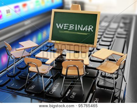 Webinar concept. Schooldesk and chalkboard on the laptop keyboard. 3d