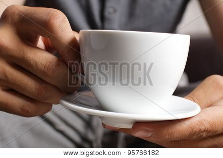 cup of coffee in the hands