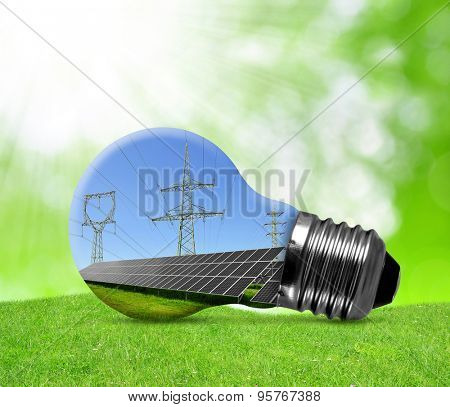 Solar panels with pylons in light bulb. Green energy concept.
