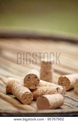 Many wine corks on wood barrel