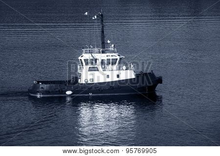 Tug Boat With White Superstructure Underway, Side View, Monochrome