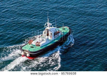Small Pilot Boat With Green Deck And Black Hull