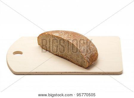 Rye Bread On A Wooden Chopping Board