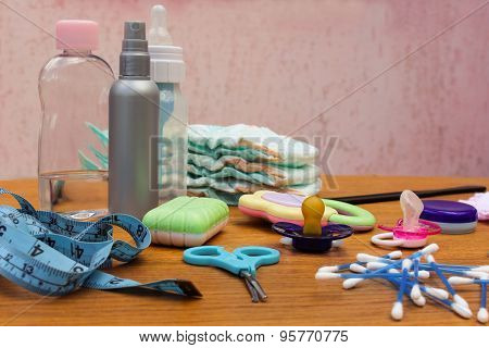 Baby accessories: pacifier, bottle, disposable diapers, scissors, funds for the bath