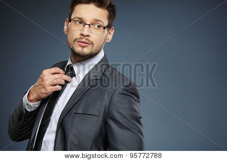 Business man wearing glasses looking to the side