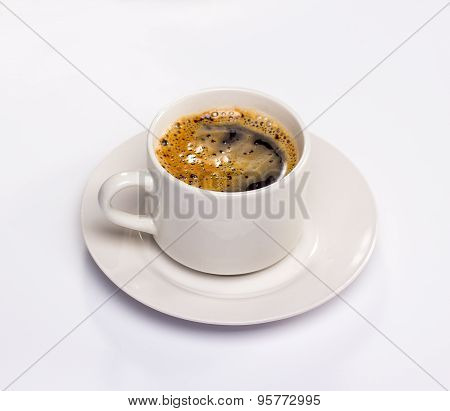 isolated white saucer and cup of black coffee with foam