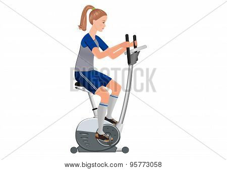 Girl and stationary bicycle.