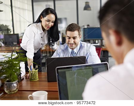 Multinational Business People Working Together In Office