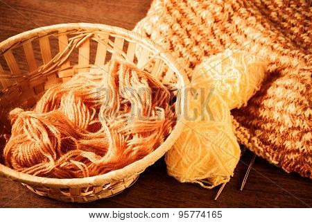 Woolen Yarn And Knitting On Wooden Background. Vintage Style