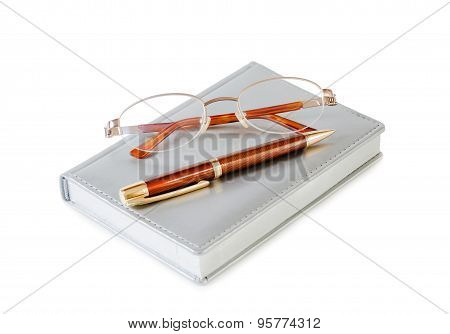 Daily Planner With Glasses And Pen On White Background