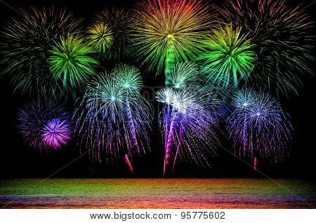 Rainbow Firework Celebration On Dark Background.