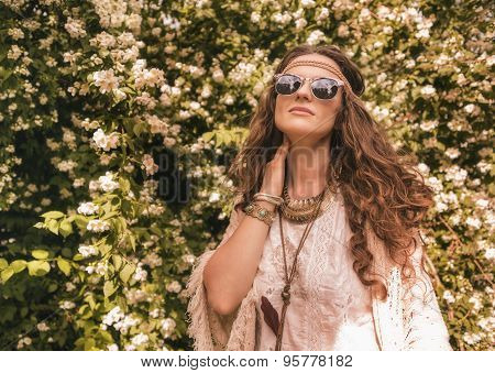 Relaxed Bohemian Young Woman Among Flowers