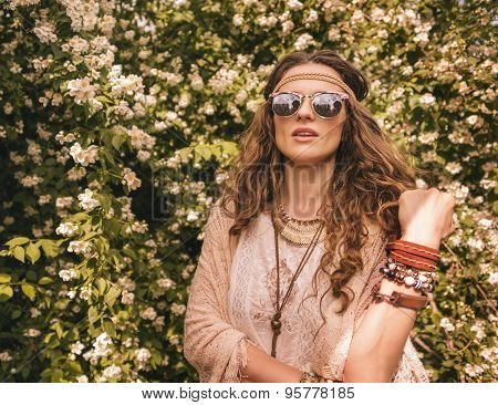 Portrait Of Boho Young Chic Among Flowers