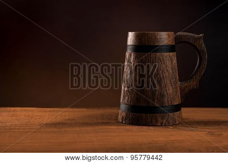 Mug Of Fresh Beer On A Wooden Table.