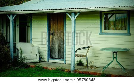 Old Summer House With Old Chairs On The Veranda