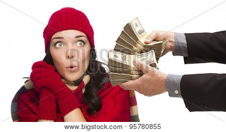Mixed Race Young Woman Wearing Holiday Clothes Being Handed Thousands of Dollars Isolated on White.