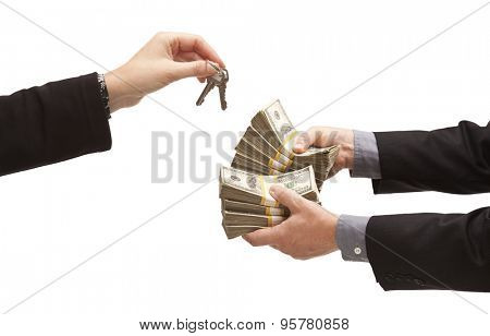 Man Handing Over Thousands of Dollars for House Keys Isolated on a White Background.